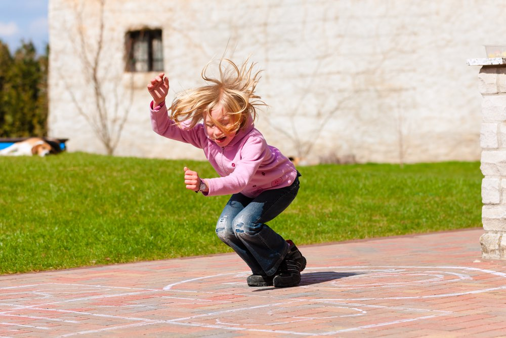 Girl Playing hopscotch
