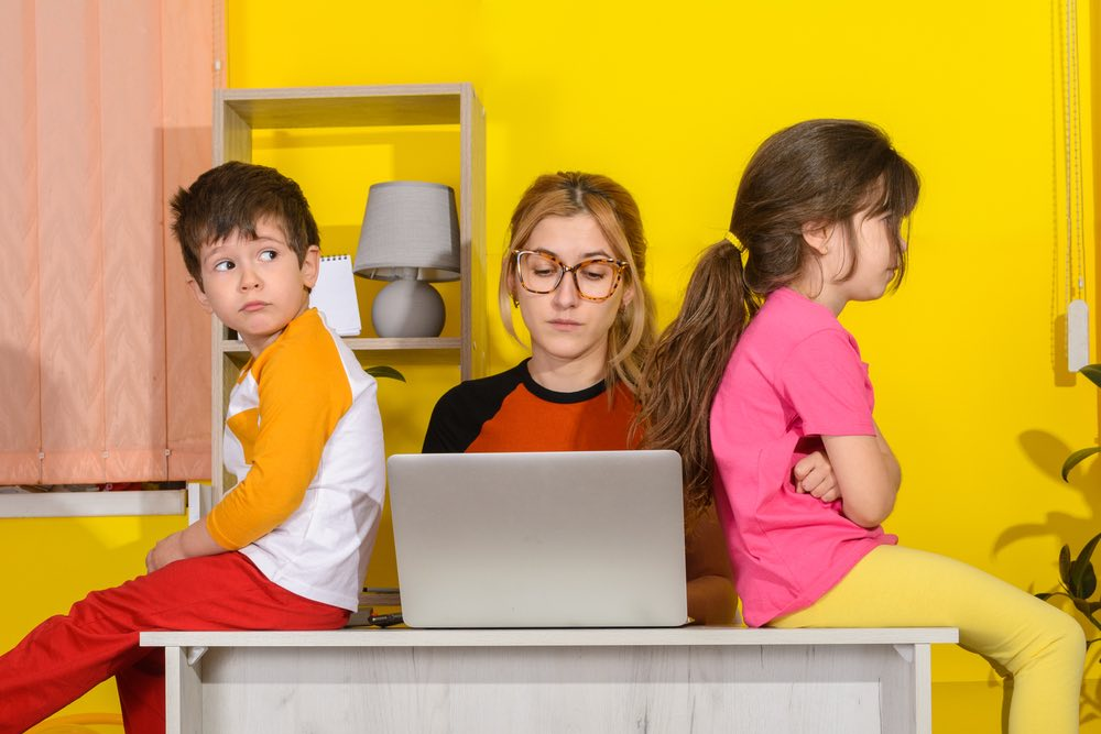 Mom bothered by Kids on her Desk