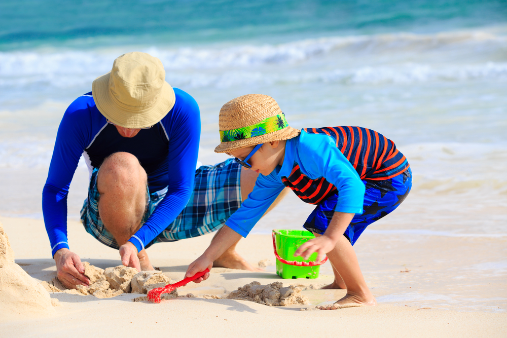Father and Son Building Sandcastles on the Beach