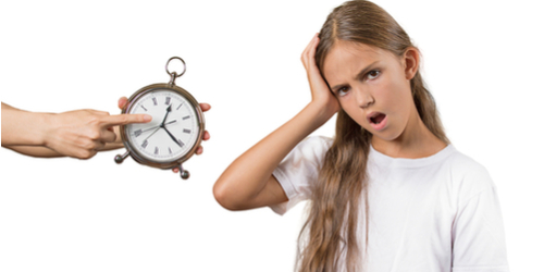 Mom showing daughter clock it's late to go to bed
