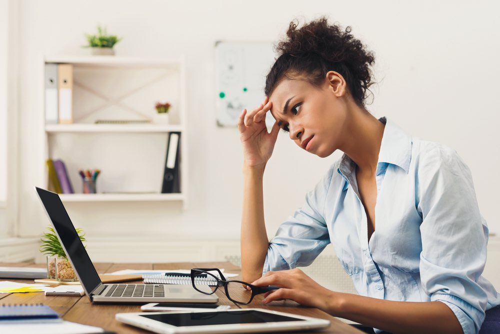 Stressed woman working at computer