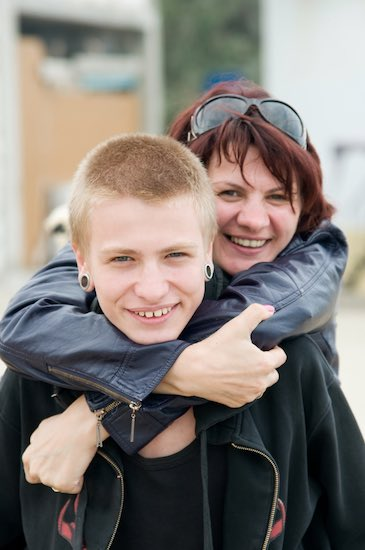 Mom hugging teenage boy