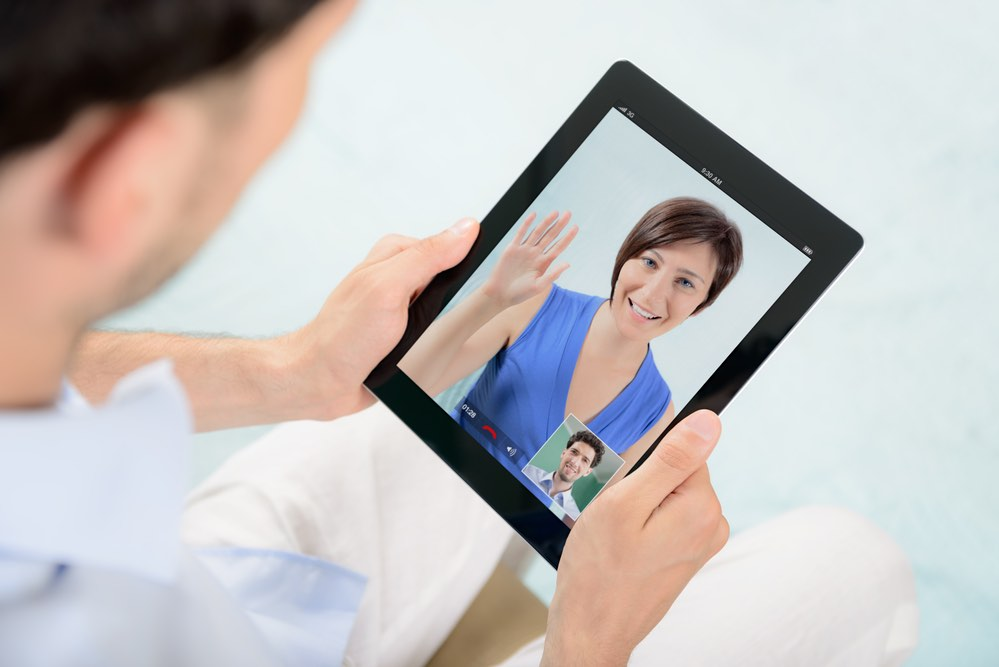 Man talking with Woman on IPad