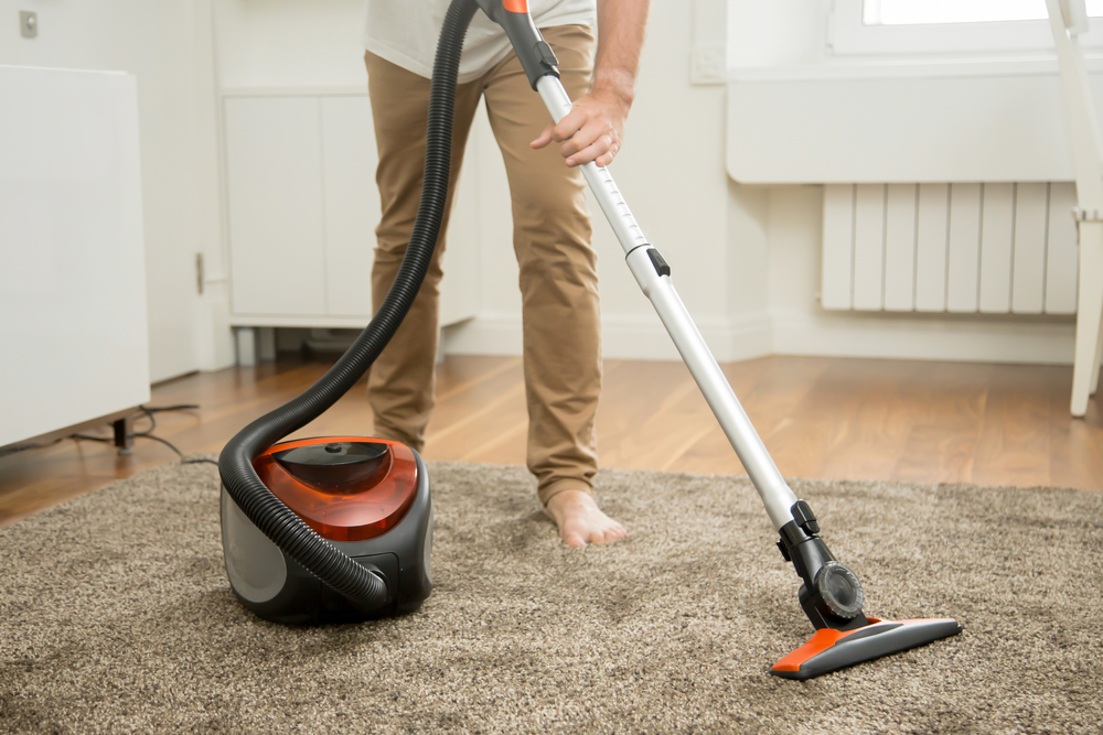Young Adult Vacuuming